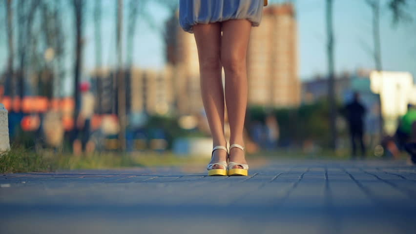 Close up of young women feet walking on street. #17718631