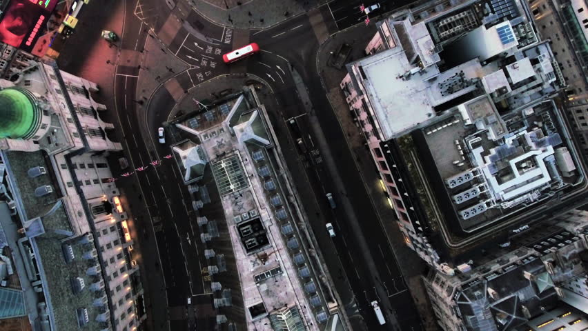 LONDON, UK - JULY 01, 2016: Bird Eye View of Piccadilly Circus on July 01, 2016 in London, England. Aerial Stock Footage of a Bird's Eye View Flying Over Piccadilly Circus and City Streets at Dusk 4K