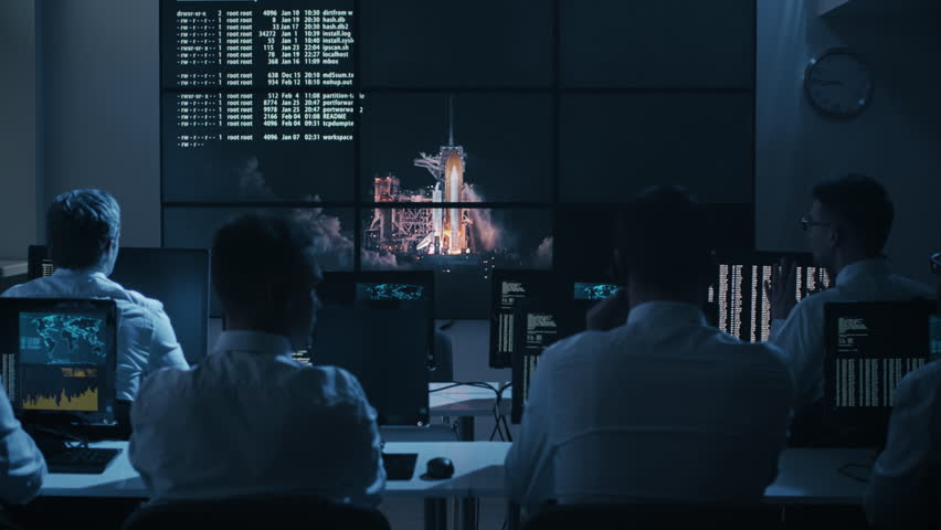 Group of People in Mission Control Center filled with Displays, Celebrating Successful Rocket Launch. Elements of this image furnished by NASA. Shot on RED Cinema Camera in 4K.