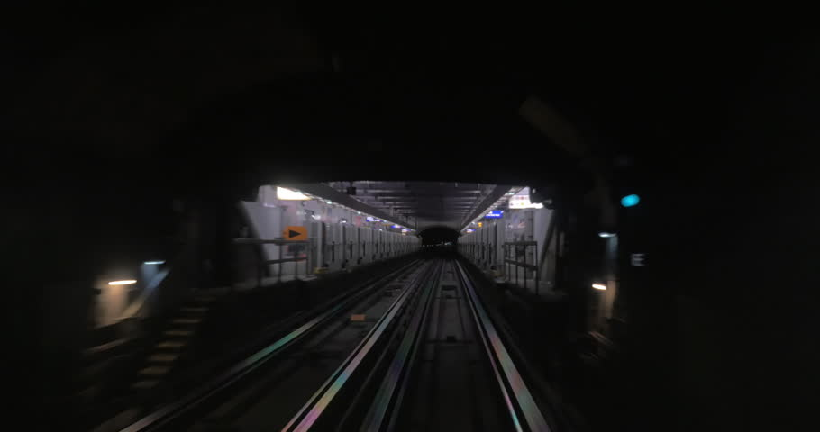 Underground train departing from one station and arriving to another one. Way through the dark subway tunnel   Shutterstock HD Video #17733634