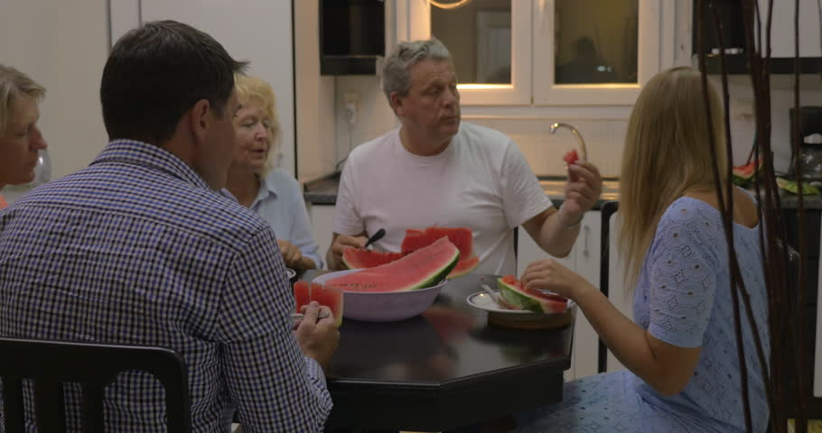 Big family having meal in the kitchen. Parents, son and grandparents eating a sweet watermelon | Shutterstock HD Video #17733643
