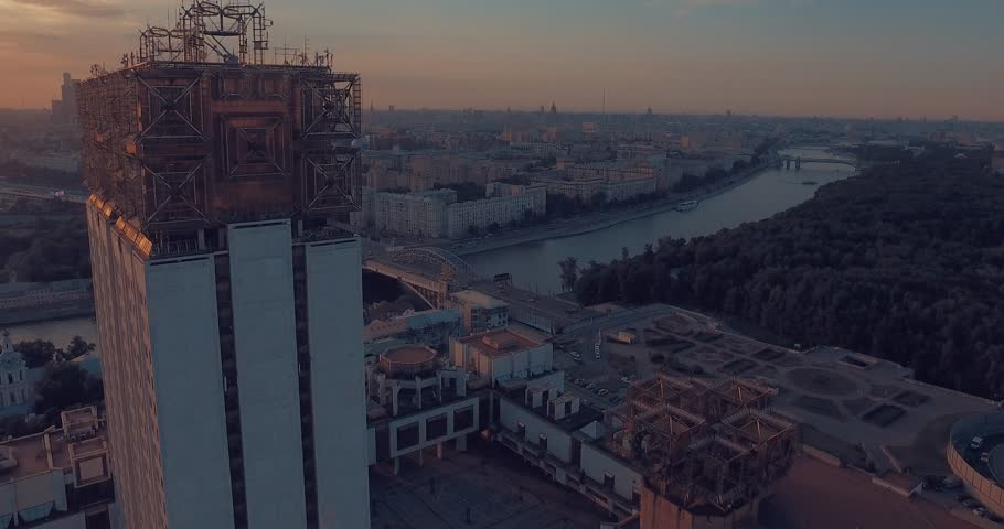 Aerial view of the Luzhnetsky metro bridge, passenger boat floating along the Moscow River, heavy traffic and building of Russian Academy of Sciences during amazing sunset  in Moscow, Russia.      | Shutterstock HD Video #17747380