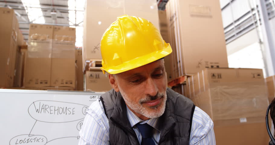 Manager working with laptop in a warehouse | Shutterstock HD Video #17757529