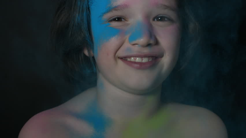 4k shoot of a cute child smiling - Holy Powder blue thrown on face | Shutterstock HD Video #17760349