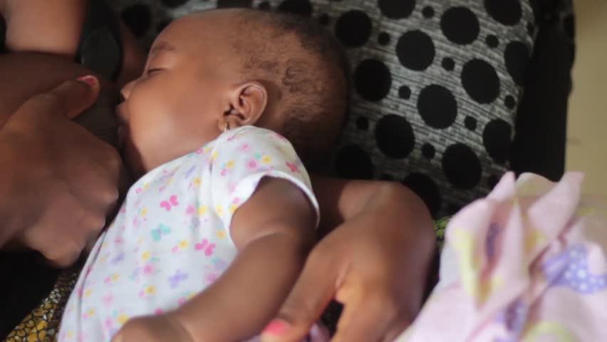 Cute African baby Girl Breast Feeding