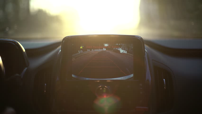 A car's backup camera in action at sunset. Close up | Shutterstock HD Video #17794726