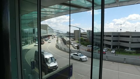 MONTREAL, CANADA JUNE 2016: Pierre Elliott Trudeau International Airport Departures Driveway - Steadicam Flow From Inside
