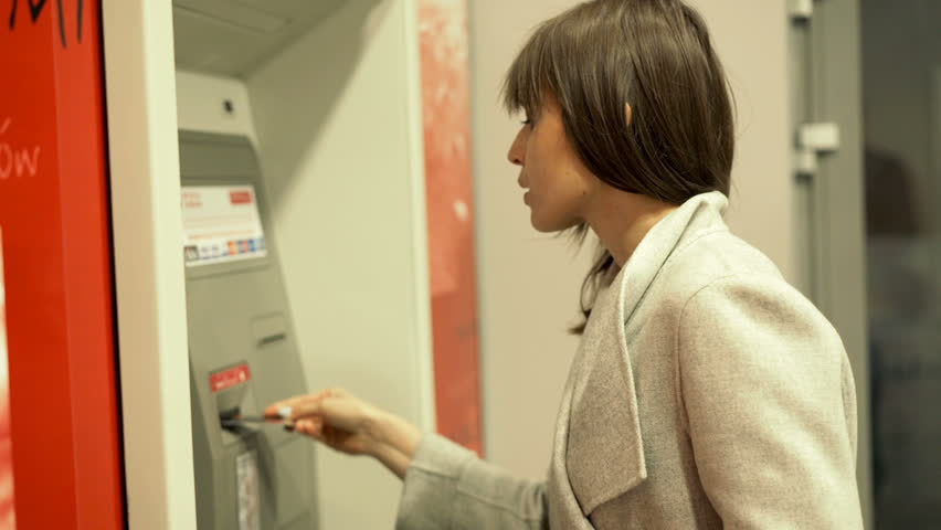 Young woman taking money from ATM machine   | Shutterstock HD Video #17800786