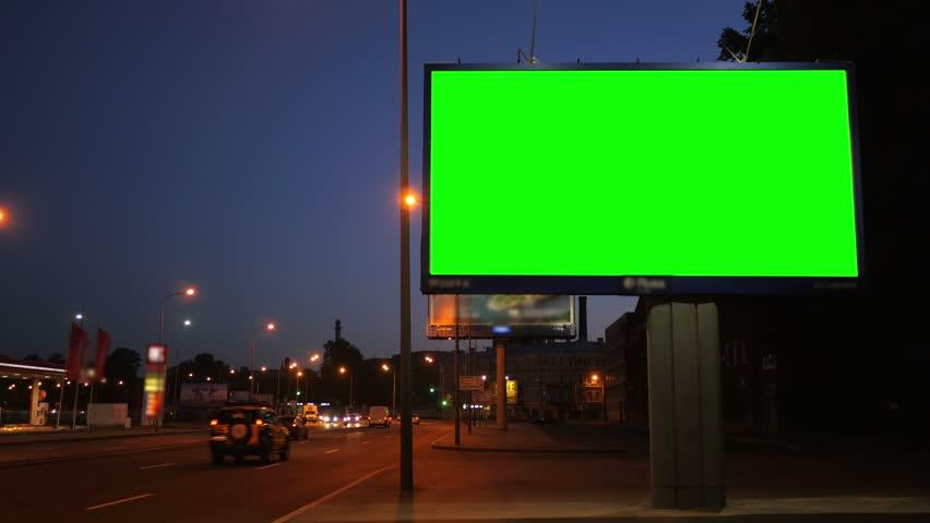 A Billboard with a Green Screen on a Busy Night Street | Shutterstock HD Video #17808562