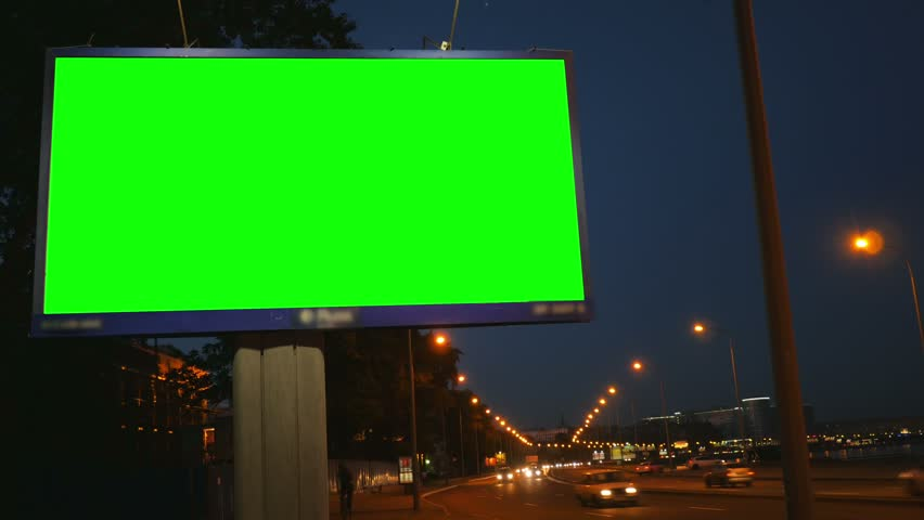 A Billboard with a Green Screen on a Busy Night Street | Shutterstock HD Video #17808571