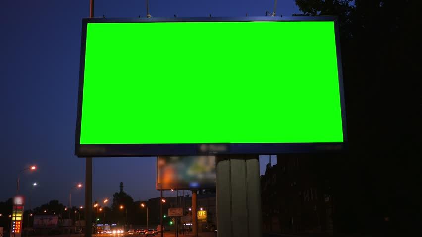 A Billboard with a Green Screen on a Busy Night Street | Shutterstock HD Video #17808598