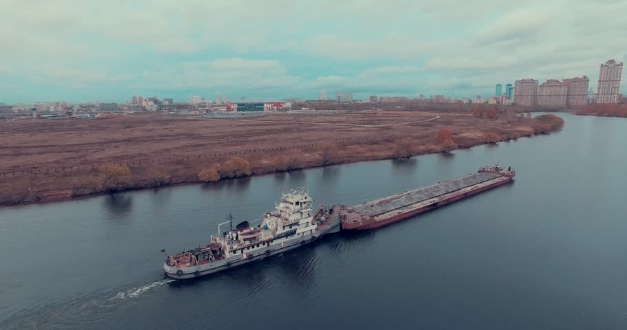 Aerial view of  barge transporting gravel down Moskva River on a cloudy autumn day in Strogino district, Moscow, Russia.   | Shutterstock HD Video #17821780