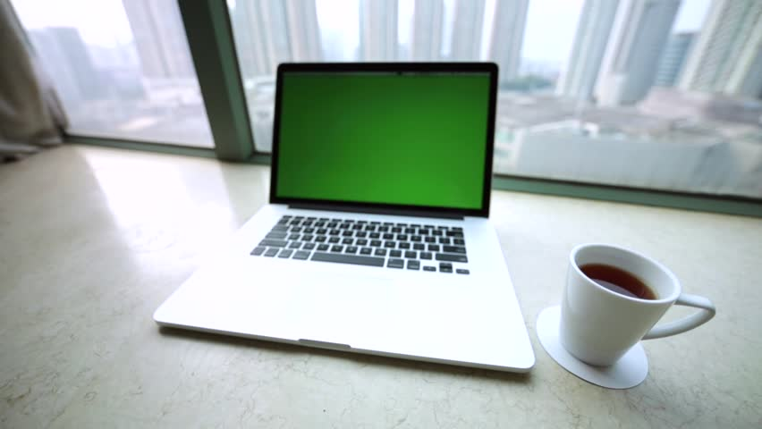 Pretty workspace with laptop, morning cup of coffee and amazing view of skyscrapers from the high window. Hong Kong, China. #17837029