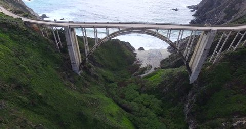 Cars drive on Highway 1 along the coast
