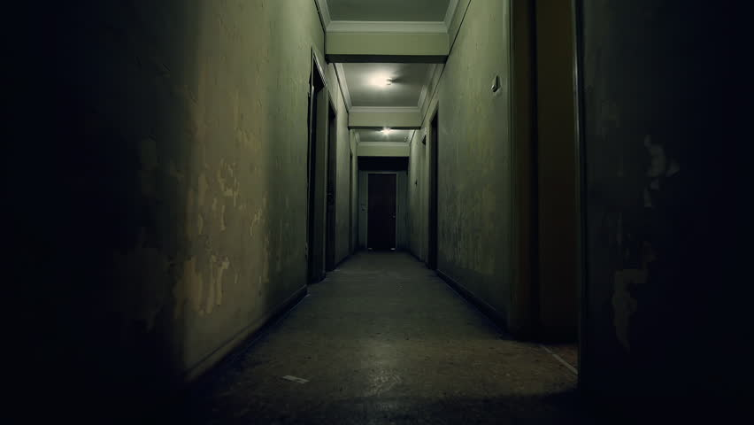 Old apartment building,long dark hallway.Tracking in on the corridor of an old apartment building,long and dark hallway.
