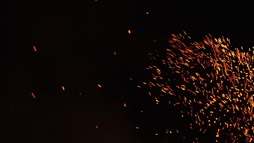 Fire sparks from campfire over black background | Shutterstock HD Video #17867428