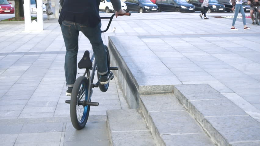 Harkov/ukraine - May 18 2016: Cyclists Ride on the Sidewalk Outside, Passing by People Who do Torfl on the Steps Cyclist Doing a Somersault, a Street Lined With Tiles, Guy on the Bike Does the Trick, | Shutterstock HD Video #17870188