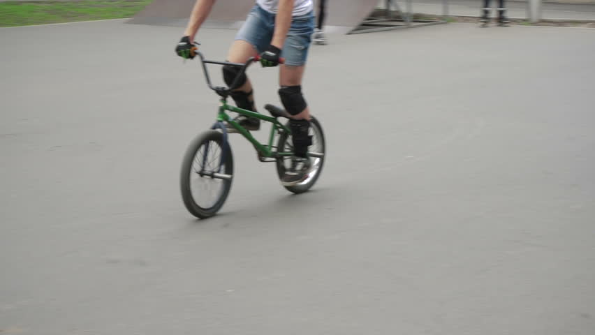 Harkov/ukraine - May 18 2016: a Young Man Riding a Bicycle and Calls in on an Inclined Surface on the Cycle Track, Cyclists on the Street Train, Knee Pads, a Guy on a Bike Does the Trick, Complex | Shutterstock HD Video #17870260