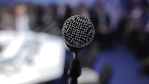 Microphone for speech stock. It appears on the right side. The microphone nobody speaks. Break in the reports.