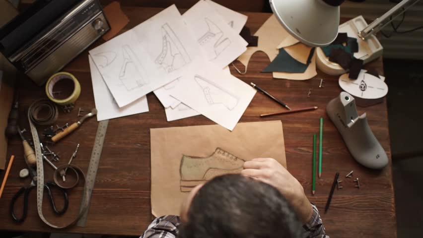 Top view of male designer in process of drawing a fashion sketch of shoes | Shutterstock HD Video #17891380