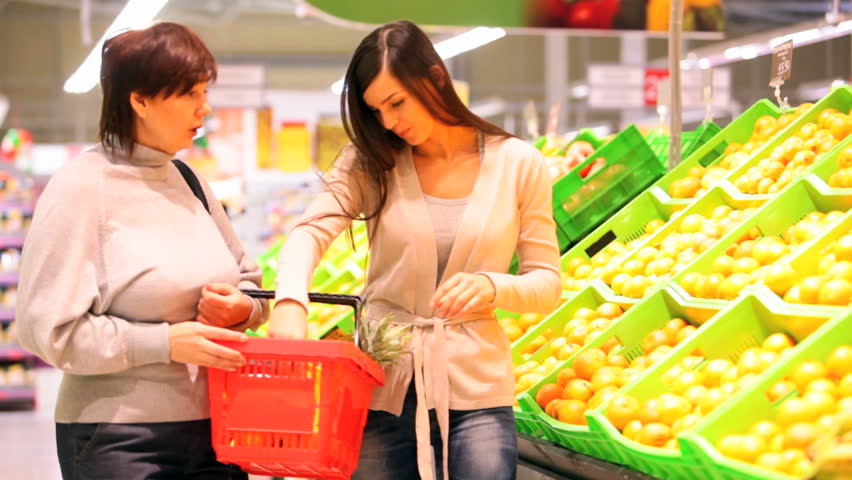 Mother and daughter buying fruit | Shutterstock HD Video #1793627