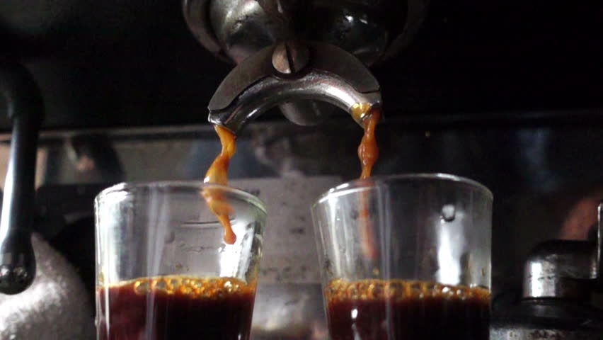 Closeup prepare double shot of espresso coffee, slow motion #17937202