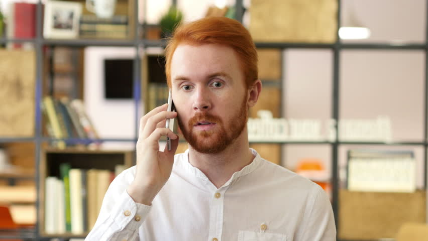 Young Designer Talking on Phone in Office | Shutterstock HD Video #17965735