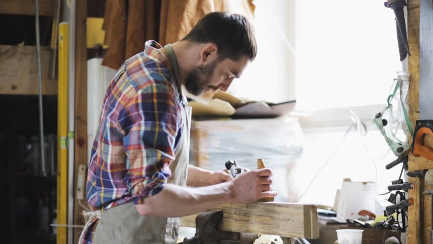Profession, people, carpentry, woodwork and people concept - carpenter working with plane and wood plank at workshop | Shutterstock HD Video #17967493