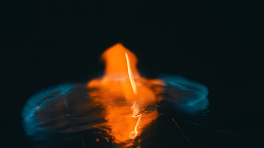 A lit match is fall down and ignites the gasoline. Blue wave at the forefront of fire go to meet. S-log - High Dynamic Range. Slow motion, high speed camera, 250fps