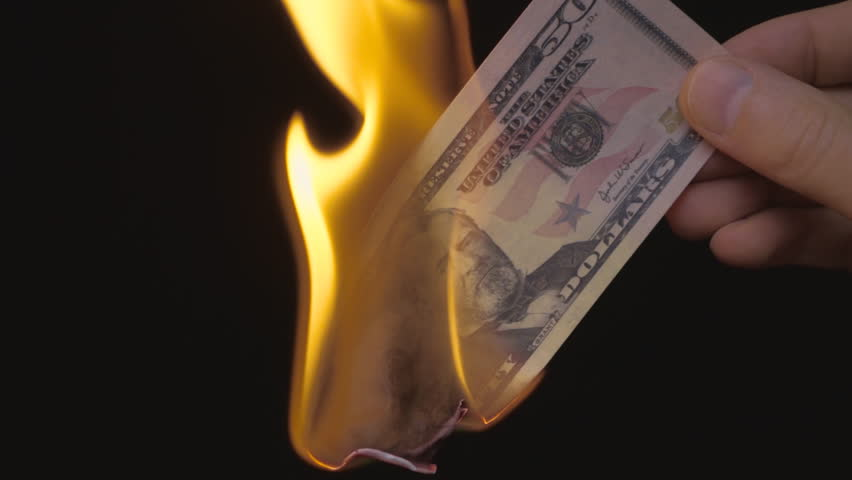 Hand holds 50 dollars on a black background, and burned it. S-log - High Dynamic Range. Slow motion, high speed camera, 250fps #17972383