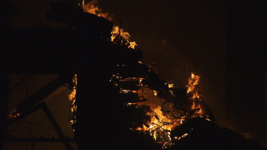 Flames eating through wall of house  | Shutterstock HD Video #17982115