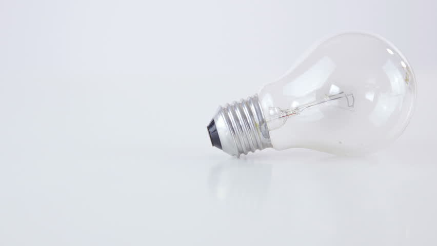 Two light bulbs on whte background 4K. Dolly sliding over two traditional light bulbs, Edison light and newest halogen bulb. | Shutterstock HD Video #17994601