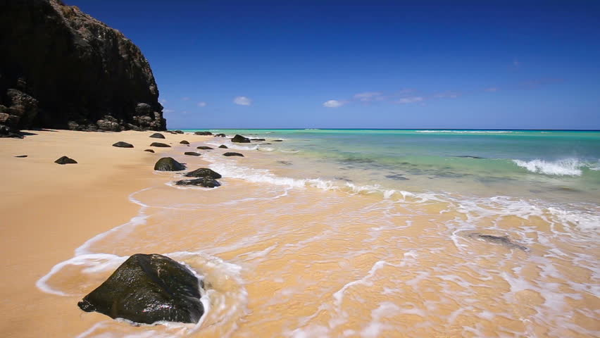 View to Costa Calma sandy beach with rocks in the south of Fuerteventura, second biggest Canary island, Spain. | Shutterstock HD Video #18021670