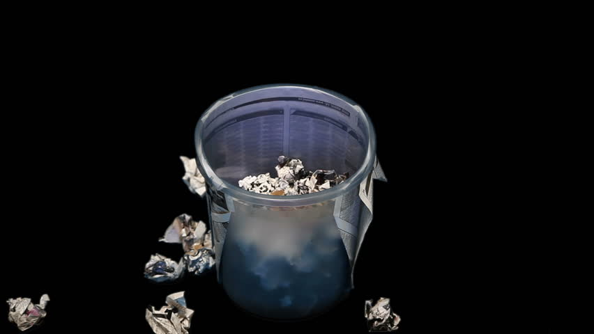 Time lapse of filling a trash bin with paper rubbish.