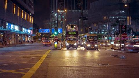 Hong Kong/hongkong - Jul 15 2016: Timelapse of Night Street Traffic in Hong Kong. the City Lights and Cars.
