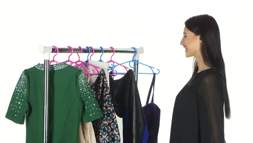 Woman shopping clothes. White | Shutterstock HD Video #18038152
