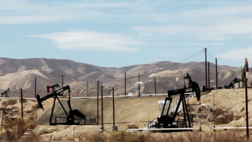 MARICOPA, CALIFORNIA - JULY 2014: Oil well pumps operating in the desert of California to help fuel America's growing need for petroleum products and promote our independence from foreign crude oil.