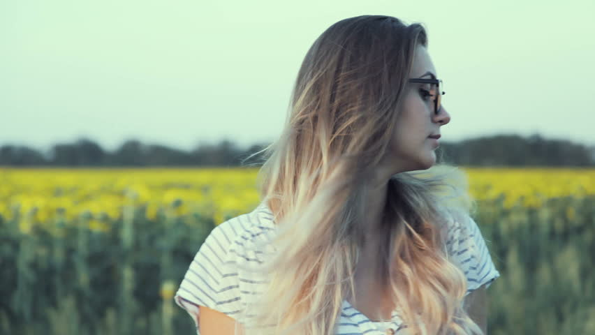 A young woman in glasses. Close-ups of the face, lips. Stylized as a movie. Blur the focus.   Shutterstock HD Video #18042865