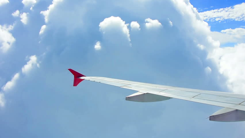 Wing airplane and cloud on sky | Shutterstock HD Video #18044965