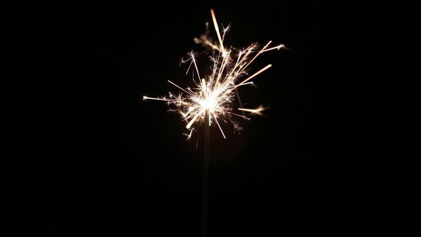 Lit sparkler in the dark | Shutterstock HD Video #18048460