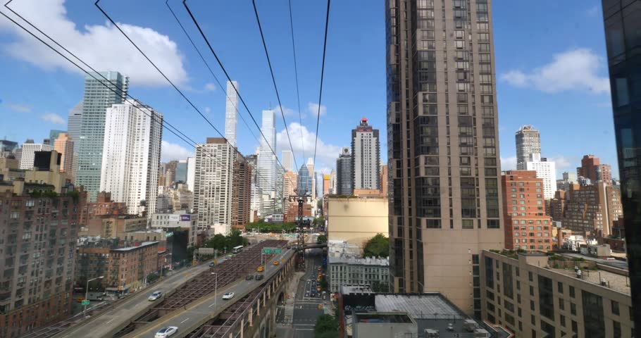 NEW YORK - Circa July, 2016 - A passenger's forward perspective riding the Roosevelt Tramway to Manhattan.     Shutterstock HD Video #18058222