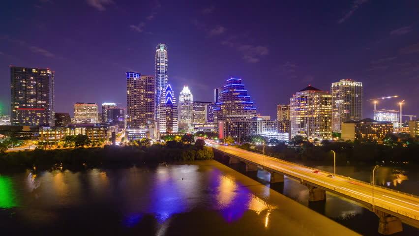 Austin, Texas, USA downtown skyline time lapse on the Colorado River.