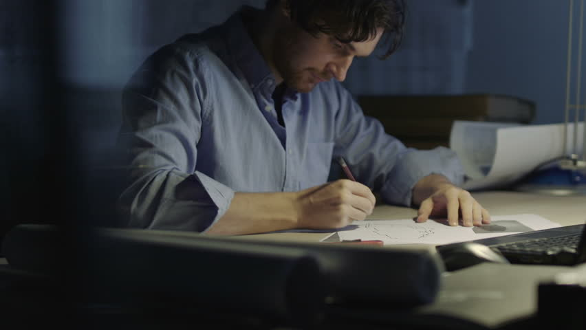 Young Man Draws A  Sketch In The Office