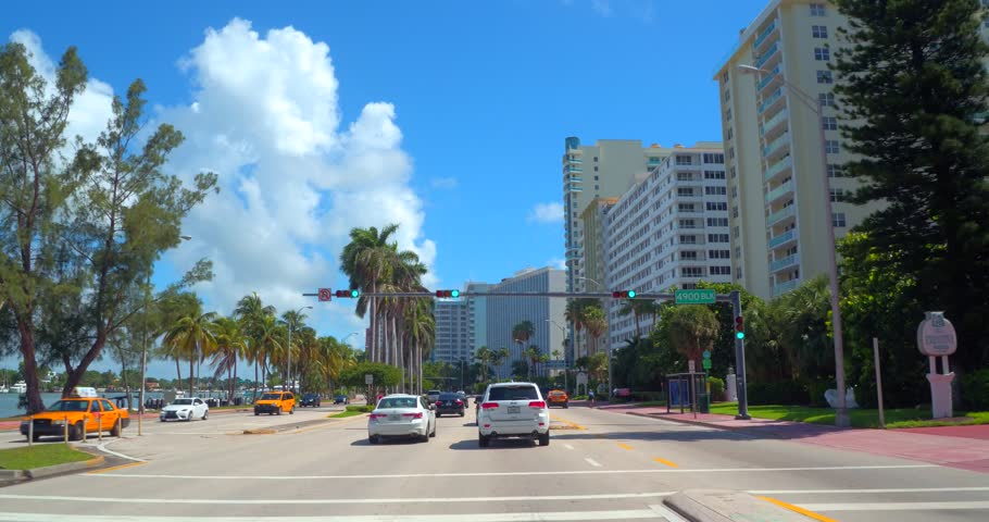 MIAMI BEACH - JULY 17: Drivers pov touring Miami Beach on Collins Avenue which is the easternmost street in Miami Beachshot with a gimbal stabilized car mounted camera July 17, 2016 in Miami Beach FL