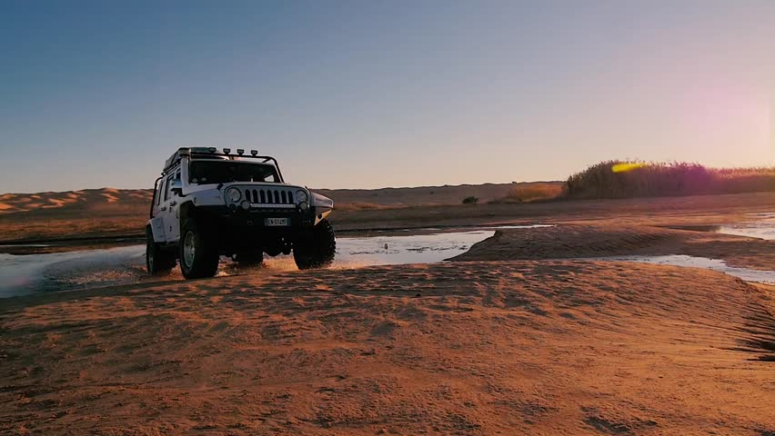 driving off-road car in the sahara desert, tunisia, 4x4 sahara adventure, november 2015