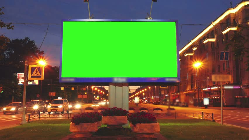 A Billboard with a Green Screen on a Busy Street.Time Lapse. | Shutterstock HD Video #18116569