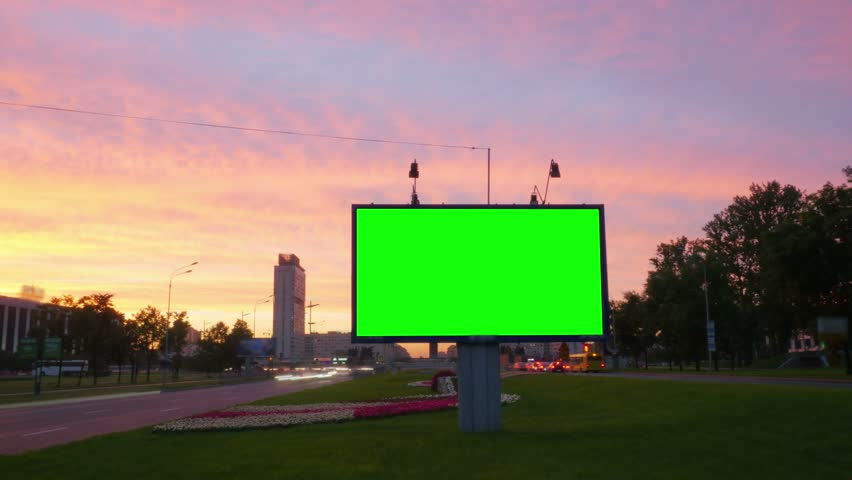 A Billboard with a Green Screen on a Busy Street.Time Lapse. | Shutterstock HD Video #18116578