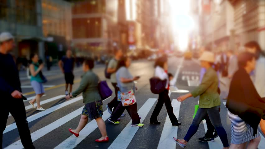 people walking in the city on crowded street. urban scenery of unrecognizable persons commuting to work in business district. new york metropolis scene background #18131500