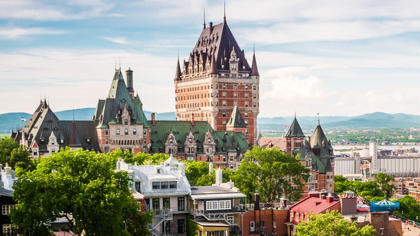 Quebec City, Canada, time lapse view of the famous Chateau Frontenac castle overlooking the Old Port of Quebec - zoom out.