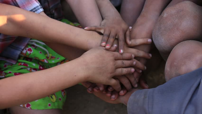 Many connecting children's hands. Mrauk-U, Myanmar. Burma #18215836